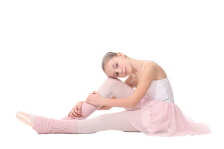 school age girl playing dress up wearing a ballet , isolated on white photo