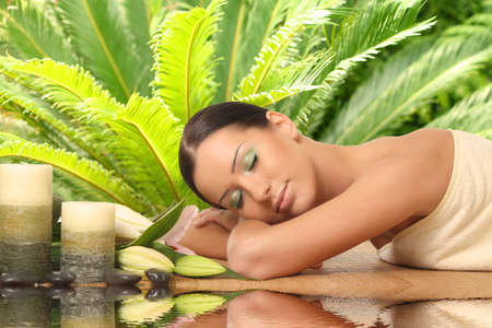 Beautiful Woman Getting Spa Massage in Spa Salon photo