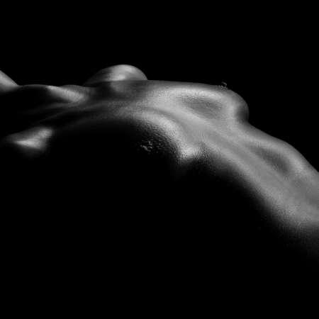 naked female body: naked female body on a black background