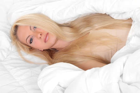Young woman in bed photo