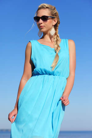 oliva: girl in a blue dress and sunglasses  Stock Photo
