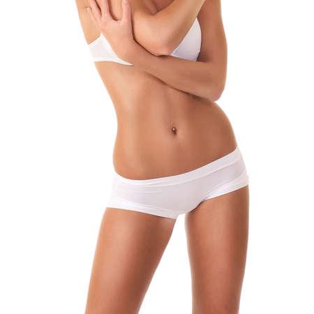 vrouw ondergoed: vrouw met een sexy lichaam in wit ondergoed Stockfoto