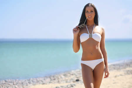 young girl bikini: young woman on the sea in a white bikini