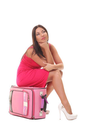 girl in a pink dress with a suitcase photo