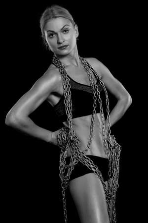 female sexy chains: athletic girl with chains