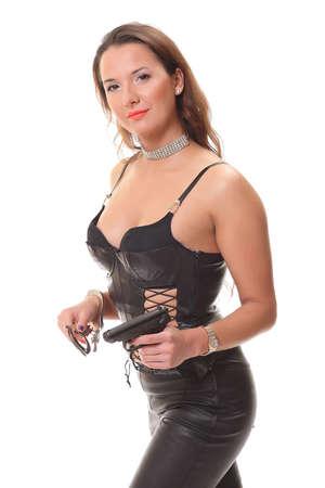 mujer con arma: Joven mujer con una pistola
