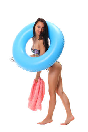 sexy female in bikini holding swimming ring photo