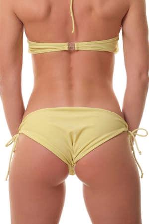 bathing   suit: Backview of female wearing bikini, isolated on white Stock Photo