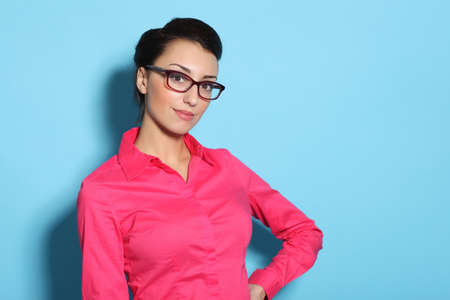 Portrait of attractive cheerful young woman in glasses