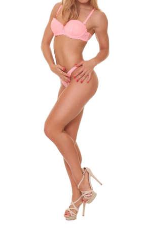 Sexy blond bodybuilder woman in bikini. photo