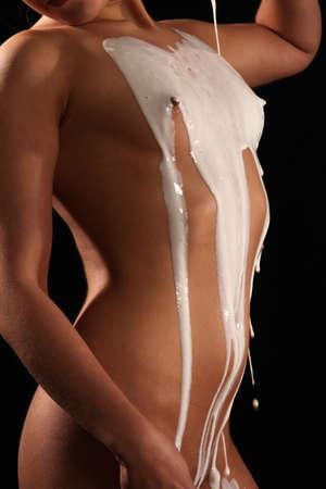naked girl pours milk Stock Photo