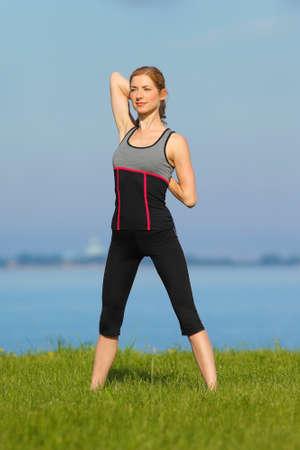 athletic girl, gymnastics at the sea photo