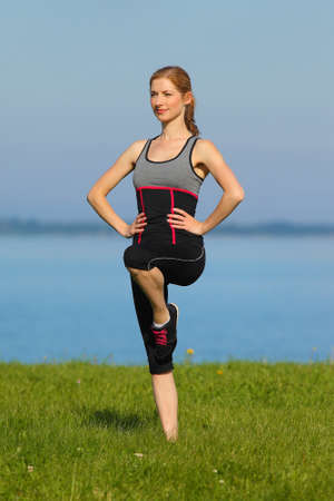 athletic girl: athletic girl, gymnastics at the sea Stock Photo