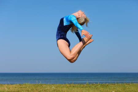 young gymnast: Young gymnast on seashore
