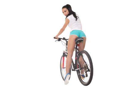 culo donna: Ragazza sexy con una moto su uno sfondo bianco