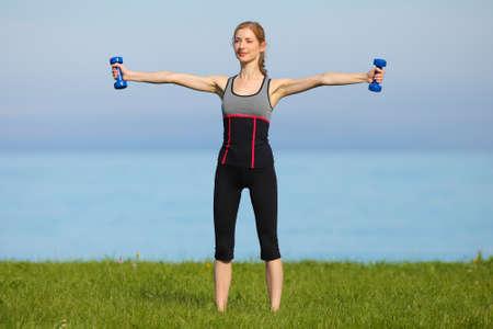 athletic girl, gymnastics at the sea Stock Photo