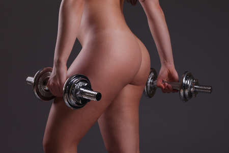 beautiful sports girl with dumbbells photo