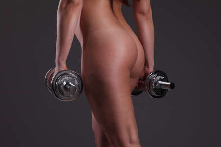 sexy butt: beautiful sports girl with dumbbells