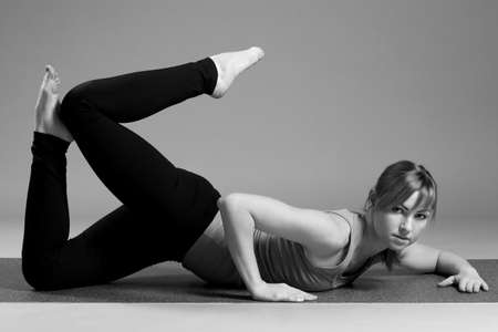 young beautiful yoga posing  .
