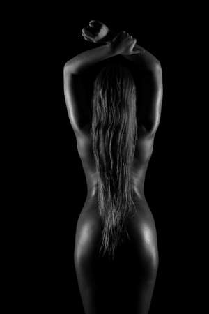 nude ass: silhouette of a naked female back and buttocks