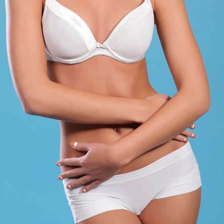 beautiful woman in white underwear. on a blue background Stock Photo