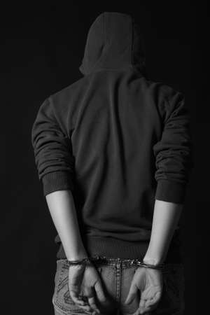illegality: Portrait of a handcuffed. black and white