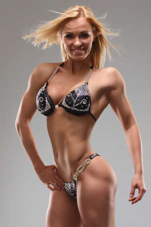 Woman with perfect athletic body photo