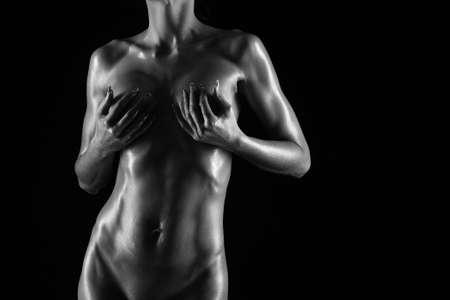 femme sexe: corps de femme nue sur un fond noir