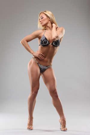 Woman with perfect athletic body . fitness bikini photo