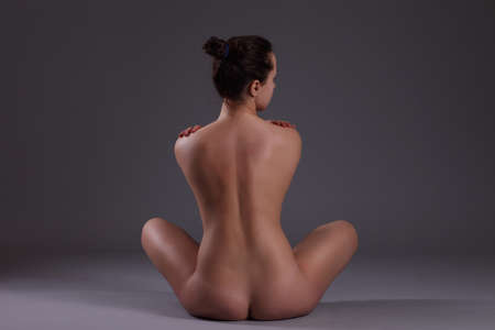 naked woman sitting: Young beautiful nude woman with towel practicing yoga