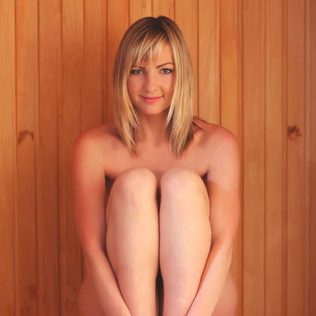 naked youth: Young woman relaxing in a sauna