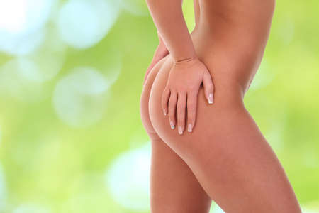 pinches: Woman pinches her thigh to control cellulite