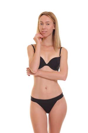 mujeres eroticas: joven rubia sexy posando en ropa interior negro.