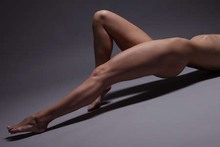 nude yoga: flexible girls nude photos . Sexy leggy girl Stock Photo