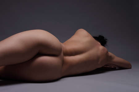 back and butt naked women.on a black background