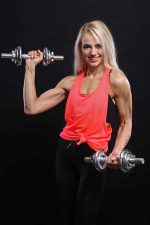 athletic girl: beautiful young athletic girl smiling with dumbbells Stock Photo