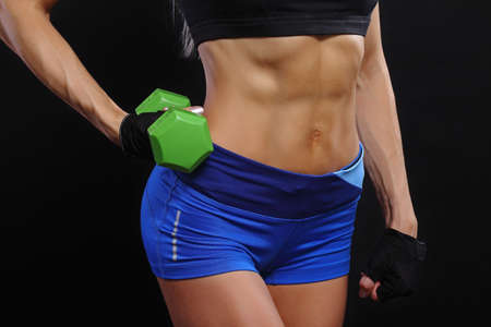 Fitness female woman with muscular body, abdominal muscles