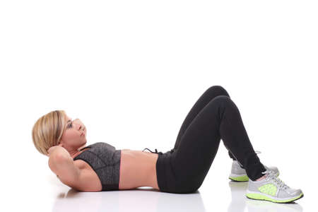 suppleness: young woman smiling and doing exercises for the abs Stock Photo