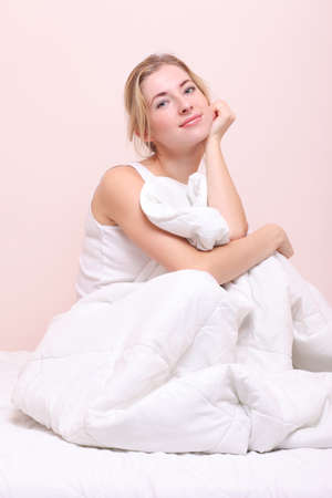 bedclothes: Young happy  woman waking up . Girl on the bed Stock Photo
