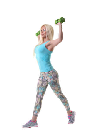 cardiovascular workout: Woman working out with dumbbells at a gym