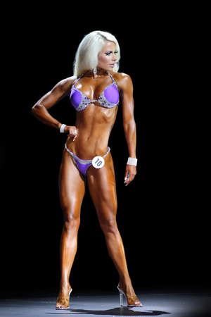 sixpack: Slim muscled woman . fitness bikini model on the stage