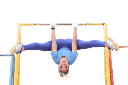 warming up: Sexy and young girl practicing on the horizontal bar Stock Photo