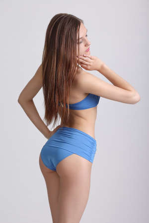 beauty female wearing bikini. Studio photo of the young girl Stock Photo