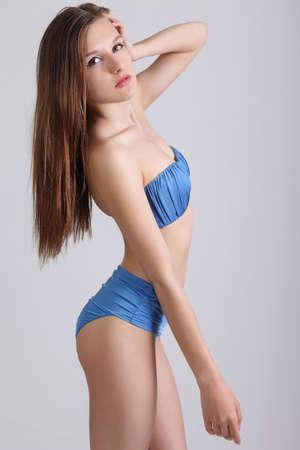 woman bath: beauty female wearing bikini. Studio photo of the young girl Stock Photo