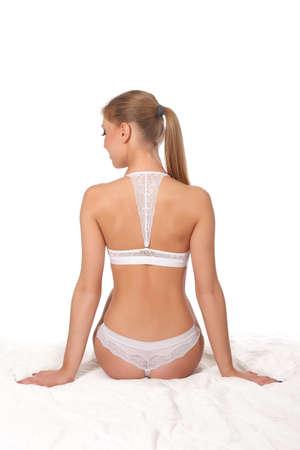buen vivir: beautiful woman in white underwear. on a white background