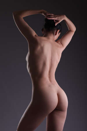 back and butt naked women . naked woman against black background. Stock Photo