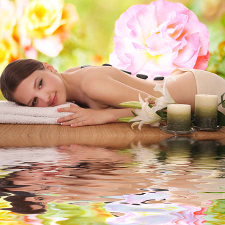 Young and beautiful woman getting spa treatment Stock Photo - 74224406