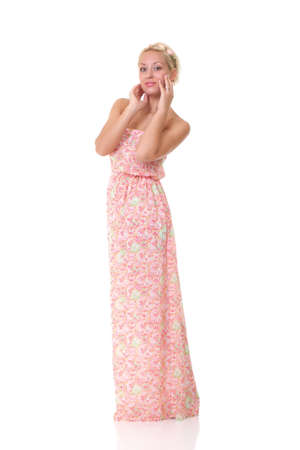 frock: Woman in Colorful Light Sundress over White Background