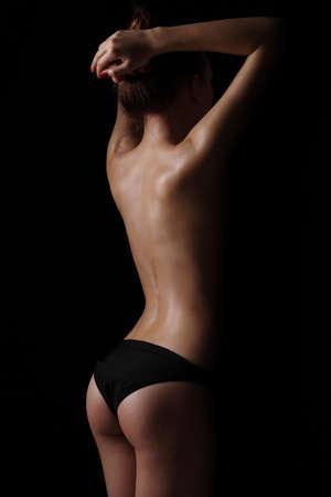 Beautiful fit, sexy female body on dark background