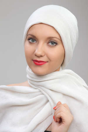 nationality: portrait of a young woman eastern type in the modern Muslim clothes and beautiful headdress Stock Photo